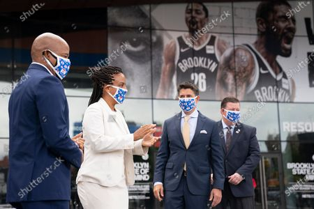 From left, Brooklyn Borough President Eric Adams, NYC Council Majority Leader, Laurie Cumbo, John Abbamondi, CEO of BSE Global, and Michael Ryan, Executive Director of the NYC Board of Elections, announce that the Barclays Center will be an early voting site, in the Brooklyn borough of New York. Early voting will be held at the sports and entertainment venue Oct. 24 through Nov. 1