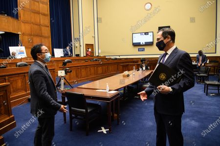 United States Secretary of the Treasury Steven T. Mnuchin (R) speaks with US Representative Andy Kim (Democrat of New Jersey) after testifying before the House Select Subcommittee on the Coronavirus Crisis on Capitol Hill in Washington, DC,.