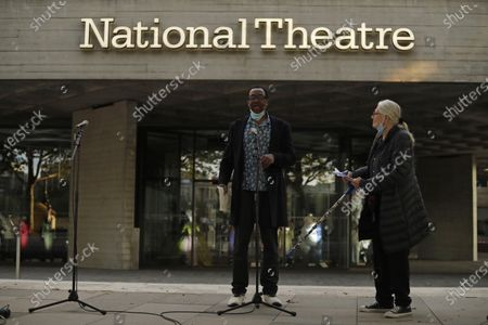 Actress and campaigner Vanessa Redgrave, listens as comedian and actor Lenny Henry speaks outside the National Theatre in London, . Vanessa Redgrave proposed that theatre people and theatre lovers should gather on the first of every month to appeal for support to raise funds to restore jobs across all the threatened arts sector and theatres, including the technical workers, across the UK