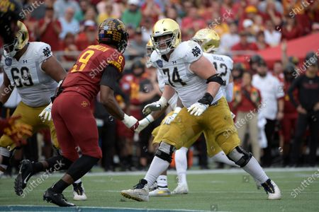 Stock Photo of File-Notre Dame offensive lineman Liam Eichenberg (74) sets up to block Iowa State linebacker Will McDonald (9) during the first half of the Camping World Bowl NCAA college football game, in Orlando, Fla. Eichenberg, who heads a veteran offensive front for line coach Jeff Quinn, is projected to be the next Irish lineman to go in the NFL Draft's first round