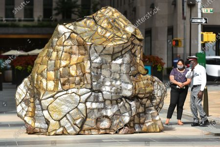 """Stock Picture of Beatriz Cortez' """"Glacial Erratic,"""" on display at Rockefeller Center in New York. A special exhibition of site-specific works by artists Ghada Amer, Beatriz Cortez, Andy Goldsworthy, Lena Henke, Camille Henrot and Thaddeus Mosley comprises the second year of Frieze Sculpture at Rockefeller Center."""