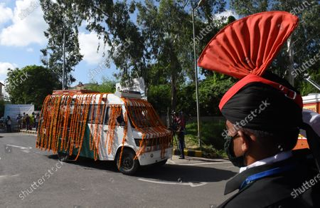 An ambulance carring the body of former president Pranab Mukherjee leaves Army Hospital for his funeral at Lodhi Cremation ground  on September 1, 2020 in New Delhi, India.
