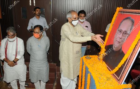 Stock Photo of BJP leader Nagendra Nath Tripathi paying tribute to former President Pranab Mukherjee a day after his death, at BJP office  on September 1, 2020 in Patna, India.