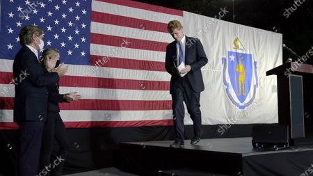 Rep. Joe Kennedy III leaves the stage after speaking outside his campaign headquarters in Watertown, Mass., after conceding defeat to incumbent U.S. Sen. Edward Markey, in the Massachusetts Democratic Senate primary. Applauding at left are his twin brother Matthew and wife Lauren