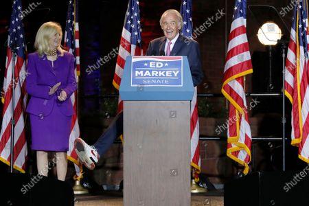 Incumbent U.S. Sen. Edward Markey displays his sneaker, in Malden, Mass., as he speaks after defeating U.S. Rep. Joe Kennedy III in the Massachusetts Democratic Senate primary. At left is his wife Susan