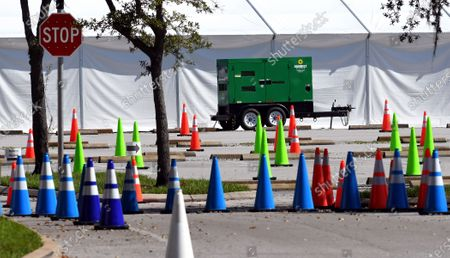 Traffic cones, tent, and a generator are seen at a nearly empty COVID-19 testing site operated by the Florida Division of Emergency Management near Walt Disney World. As the number of coronavirus cases in Florida has dropped in recent weeks, so has the demand for testing.