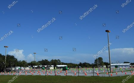 Traffic cones are seen in a parking lot at a nearly empty COVID-19 testing site operated by the Florida Division of Emergency Management near Walt Disney World.  As the number of coronavirus cases in Florida has dropped in recent weeks, so has the demand for testing.