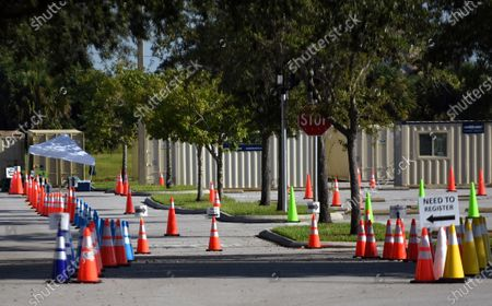 Traffic cones are seen at a nearly empty COVID-19 testing site operated by the Florida Division of Emergency Management near Walt Disney World. As the number of coronavirus cases in Florida has dropped in recent weeks, so has the demand for testing.