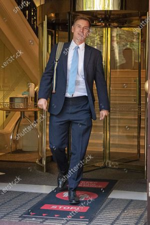 Former Health Secretary Jeremy Hunt departs television studios near Parliament after appearing on Kay Burley at Breakfast.