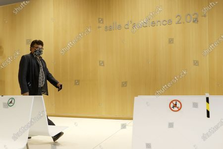 Stock Image of French writer, activist and specialist of emergency medical services Patrick Pelloux   walks to the courtroom in which the Charlie Hebdo terror attack trial will be held at the courthouse in Paris, France, 02 September 2020. The trial will be held from 02 September to 10 November 2020. The Charlie Hebdo terrorist attacks in Paris happened on 07 January 2015, with the storming of armed Islamist extremists of the satirical newspaper, starting three days of terror in the French capital.