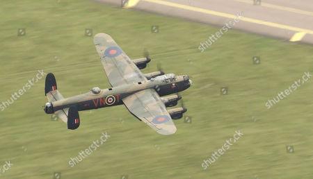Lancaster in flight over RAF Coningsby.