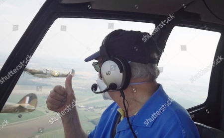 David Jason takes to the skies and gives a thumbs up as a Spitfire and a Hurricane fly past during a training exercise of the Battle of Britain Memorial Flight.