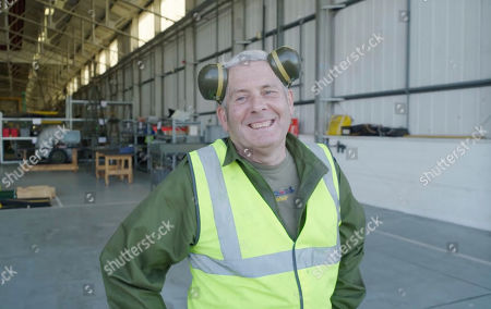 Lancaster ground crew engineer Cpl Norman Pringle is ready for another cup of tea !