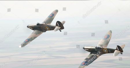 Hurricane and Spitfire in flight over RAF Coningsby.