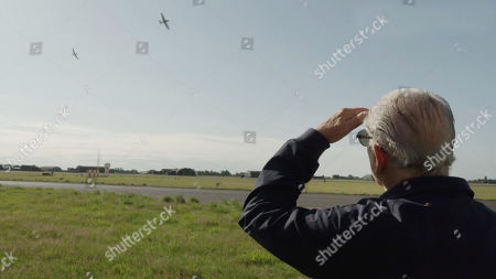 David Jason watching as a Spitfire and a Hurricane fly past during a training exercise of the Battle of Britain Memorial Flight.