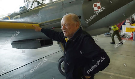 Stock Photo of David Jason helps move an iconic Battle of Britain Spitfire at RAF Coningsby.