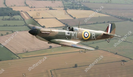 WW2 Spitfire in flight over RAF Coningsby.