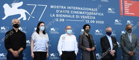 European Festival directors  Jose Luis Rebordinos (San Sebastian International Film Festival, Karel Och (Karlovy Vary International Film Festival), Vanja Kaludjercic (International Film Festival Rotterdam), Lili Hinstin (Locarno Film Festival), Thierry Fremaux (Festival de Cannes) and Alberto Barbera (Venice Film Festival), all wearing protective face masks, pose during a photocall at the 77th annual Venice International Film Festival, in Venice, Italy, 02 September 2020. The event is the first major in-person film fest to be held in the wake of the Covid-19 coronavirus pandemic. Attendees have to follow strict safety measures like mandatory face masks indoors, temperature scanners, and socially distanced screenings to reduce the risk of infection. The public is barred from the red carpet, and big stars are expected to be largely absent this year. The 77th edition of the festival runs from 02 to 12 September 2020.