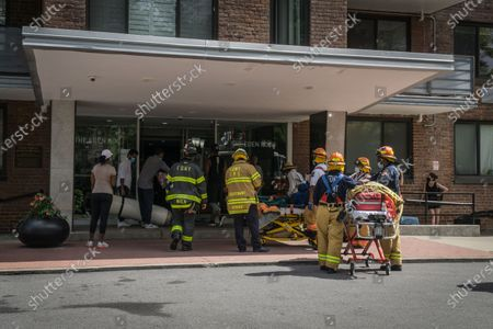 Multiple fire engines respond to a fire in a high rise residential building in Harlem. Later New York City Fire Department Commissioner Daniel Nogro held a press conference to congratulate fire fighter Brian Quinn from Ladder Company 30 on a heroic rescue of a woman hanging out of her 16th floor window.