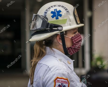 Firefighter during New York City Fire Department Commissioner Daniel Nogro held a press conference to congratulate fire fighter Brian Quinn from Ladder Company 30 on a heroic rescue of a woman hanging out of her 16th floor window.