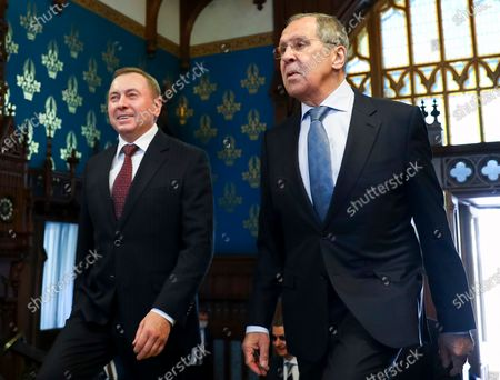 In this handout photo released by Russian Foreign Ministry Press Service, Russian Foreign Minister Sergey Lavrov, right, and Belarus Foreign Minister Vladimir Makei enter a hall for their talks in Moscow, Russia, . Makei thanked Russia for its support of the Belarusian government amid protests