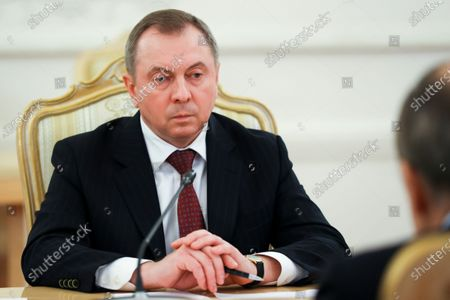 Stock Image of In this handout photo released by Russian Foreign Ministry Press Service, Belarus Foreign Minister Vladimir Makei listens to Russian Foreign Minister Sergey Lavrov during their talks in Moscow, Russia, . Makei thanked Russia for its support of the Belarusian government amid protests
