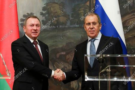 In this handout photo released by Russian Foreign Ministry Press Service, Russian Foreign Minister Sergey Lavrov, right, and Belarus Foreign Minister Vladimir Makei shake hands after their joint news conference following the talks in Moscow, Russia, . Makei thanked Russia for its support of the Belarusian government amid protests