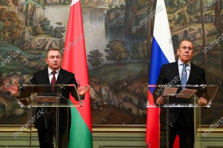In this handout photo released by Russian Foreign Ministry Press Service, Russian Foreign Minister Sergey Lavrov, right, and Belarus Foreign Minister Vladimir Makei attend a joint news conference following the talks in Moscow, Russia, . Makei thanked Russia for its support of the Belarusian government amid protests