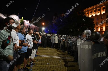 People shout slogans during an anti-government protest held in front of the Parliament building in Sofia, Bulgaria, 02 September 2020. Hundreds of demonstrators once again gathered in the capital's downtown area to demand the resignation of Prime Minister Boyko Borisov and his government.