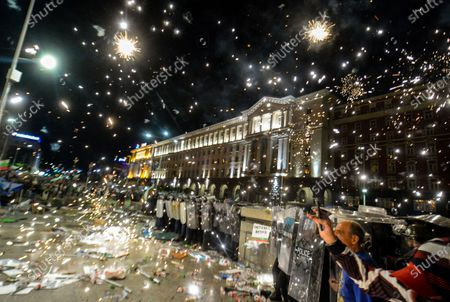Fireworks illuminate the gendarmerie units during an anti-government protest held in front of the Parliament building in Sofia, Bulgaria, 02 September 2020. Hundreds of demonstrators once again gathered in the capital's downtown area to demand the resignation of Prime Minister Boyko Borisov and his government.