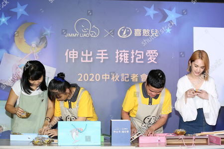 Rainie Yang attends a mid-autumn festival event which was held by 'Children Are Us' foundation.