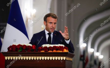 French President Emmanuel Macron gestures as he speaks during a news conference with Iraq's President Barham Salihat (not pictured) at the Salam Palace in Baghdad, Iraq, 02 September 2020.