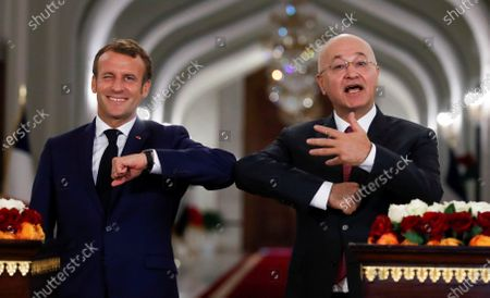 French President Emmanuel Macron (L) and Iraq's President Barham Salihat attend a news conference at the Salam Palace in Baghdad, Iraq, 02 September 2020.