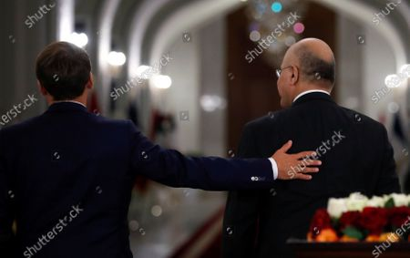 French President Emmanuel Macron (L) following a news conference with Iraq's President Barham Salihat (R) at the Salam Palace in Baghdad, Iraq, 02 September 2020.