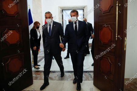 French President Emmanuel Macron (C) arrives for a meeting with Iraqi Prime Minister Mustafa al-Kadhimi in Baghdad, Iraq, 02 September 2020.