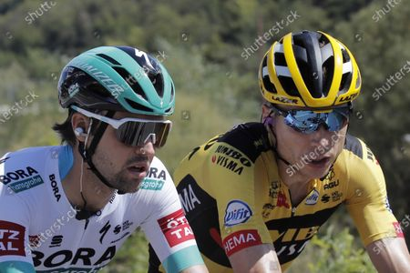 German Maximilian Schachmann, left, and German Tony Martin, right, ride with the pack during the fifth stage of the Tour de France cycling race over 183 kilometers (114 miles), with start in Gap and finish in Privas