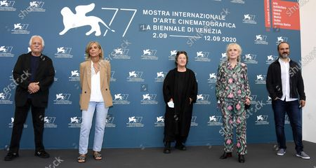 Members of Venezia of 'Orizzonti' section Jury  Katriel Schory, Francesca Comencini, Christine Vachon, Claire Denis and Oskar Alegria pose during the 77th annual Venice International Film Festival, in Venice, Italy, 02 September 2020. The event is the first major in-person film fest to be held in the wake of the Covid-19 coronavirus pandemic. Attendees have to follow strict safety measures like mandatory face masks indoors, temperature scanners, and socially distanced screenings to reduce the risk of infection. The public is barred from the red carpet, and big stars are expected to be largely absent this year. The 77th edition of the festival runs from 02 to 12 September 2020.