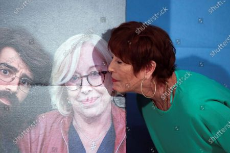 Spanish actress Veronica Forque kisses the photograph of late Spanish actress Rosa Maria Sarda during the presentation of the film 'Coming out of the Closet' in Madrid, Spain, 02 September 2020.