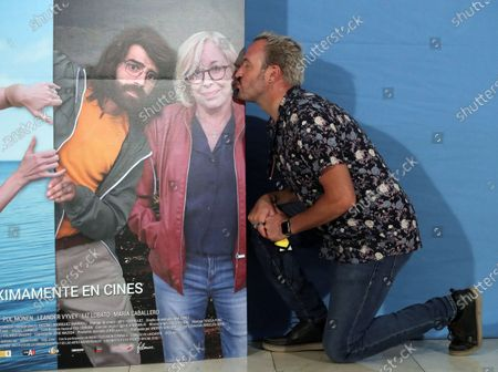 Alex O'Dogherty kisses the photograph of late Spanish actress Rosa Maria Sarda during the presentation of the film 'Coming out of the Closet' in Madrid, Spain, 02 September 2020.