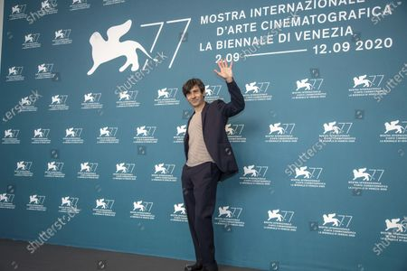 Actor Luigi Lo Cascio poses during the photo call for the movie Lacci opening the 77th edition of the Venice Film Festival at the Venice Lido, Italy, . The Venice Film Festival will go from Sept. 2 through Sept. 12. Italy was among the countries hardest hit by the coronavirus pandemic, and the festival will serve as a celebration of its re-opening and a sign that the film world, largely on pause since March, is coming back as well