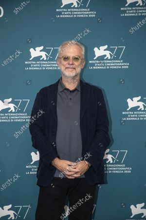 Director Daniele Luchetti poses during the photo call for the movie Lacci opening the 77th edition of the Venice Film Festival at the Venice Lido, Italy, . The Venice Film Festival will go from Sept. 2 through Sept. 12. Italy was among the countries hardest hit by the coronavirus pandemic, and the festival will serve as a celebration of its re-opening and a sign that the film world, largely on pause since March, is coming back as well