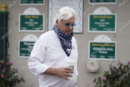 Trainer Bob Baffert walks outside of his stables at Churchill Downs, in Louisville, Ky. The 146th running of the Kentucky Derby is scheduled for Saturday, Sept. 5