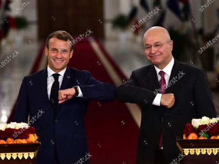 French President Emmanuel Macron during a press conference with Iraqi President Barham Salih (R) at the presidential palace in Baghdad, Iraq, 02 September 2020. Macron arrived in Iraq's capital city Baghdad on his first official visit to the country.