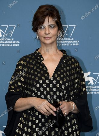 Laura Morante poses at a photocall for 'Lacci' during the 77th annual Venice International Film Festival, in Venice, Italy, 02 September 2020. The event is the first major in-person film fest to be held in the wake of the Covid-19 coronavirus pandemic. Attendees have to follow strict safety measures like mandatory face masks indoors, temperature scanners, and socially distanced screenings to reduce the risk of infection. The public is barred from the red carpet, and big stars are expected to be largely absent this year. The 77th edition of the festival runs from 02 to 12 September 2020.