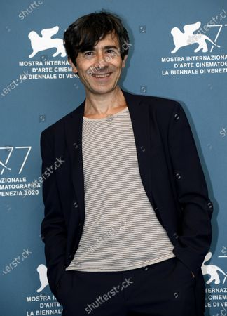 Luigi Lo Cascio poses at a photocall for 'Lacci' during the 77th annual Venice International Film Festival, in Venice, Italy, 02 September 2020. The event is the first major in-person film fest to be held in the wake of the Covid-19 coronavirus pandemic. Attendees have to follow strict safety measures like mandatory face masks indoors, temperature scanners, and socially distanced screenings to reduce the risk of infection. The public is barred from the red carpet, and big stars are expected to be largely absent this year. The 77th edition of the festival runs from 02 to 12 September 2020.