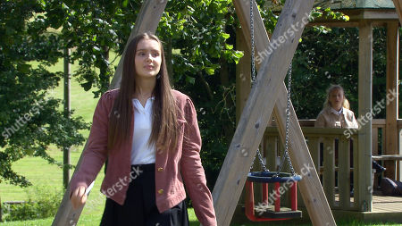 Emmerdale - Ep 8839 Thursday 17th September 2020 - 2nd Ep Amelia Spencer, as played by Daisy Campbell, refuses to go shopping with Sarah Sugden, as played by Katie Hill, and the stolen credit card, but when Sarah heads off, she leaves the card on the bench.
