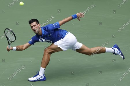 Novak Djokovic of Serbia hits a return to Kyle Edmund of Great Britain during their match on the third day of the US Open Tennis Championships the USTA National Tennis Center in Flushing Meadows, New York, USA, 02 Septemeber 2020. Due to the coronavirus pandemic, the US Open is being played without fans and runs from 31 August through 13 September.