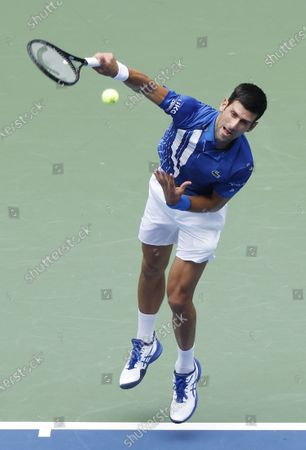 Novak Djokovic of Serbia serves to Kyle Edmund of Great Britain during their match on the third day of the US Open Tennis Championships the USTA National Tennis Center in Flushing Meadows, New York, USA, 02 Septemeber 2020. Due to the coronavirus pandemic, the US Open is being played without fans and runs from 31 August through 13 September.