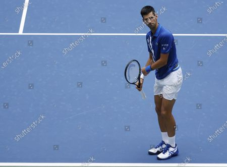 Novak Djokovic of Serbia reacts as he plays Kyle Edmund of Great Britain during their match on the third day of the US Open Tennis Championships the USTA National Tennis Center in Flushing Meadows, New York, USA, 02 Septemeber 2020. Due to the coronavirus pandemic, the US Open is being played without fans and runs from 31 August through 13 September.