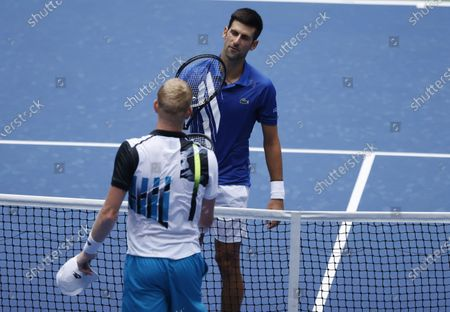 Novak Djokovic of Serbia (T) at the net with Kyle Edmund of Great Britain affter their match on the third day of the US Open Tennis Championships the USTA National Tennis Center in Flushing Meadows, New York, USA, 02 Septemeber 2020. Due to the coronavirus pandemic, the US Open is being played without fans and runs from 31 August through 13 September.